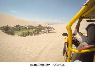 A view of Huacachina from a dune buggy.