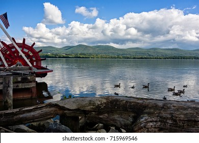 A view of the Hudson River from Newburgh, New York, Orange County.   Mount Beacon is the backdrop for the river, where ducks are swimming and a red paddle of a river boat is visible on the left.