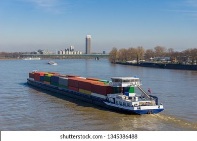 View of a huge container ship with many large containers driving through the Rhine in Germany Cologne in 2019.