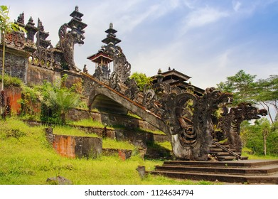 View to huge gate with stone dragons of Mother Temple, Pura Besakih, Balinese largest Hindu temple and most famous place of worship. Bali, Indonesia.