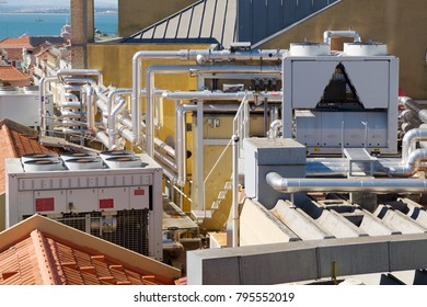 View of a huge group of air conditioning on a roof.