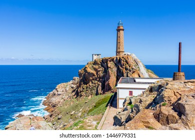 View of the huge rock where the tower of Cape Vilán lighthouse is located, to access it there is a covered tunnel that goes up to the rock, Galicia, Spain