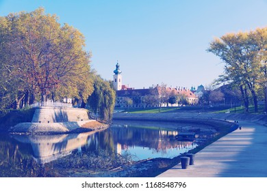 View of hungarian city Gyor with river Raba in sunny autumn