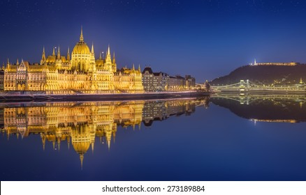 View of hungarian Parliament building and Liberty Statue at night in Budapest, Hungary