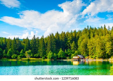 View of hut on lower lake in Fusine, Tarvisio, Friuli, Italy