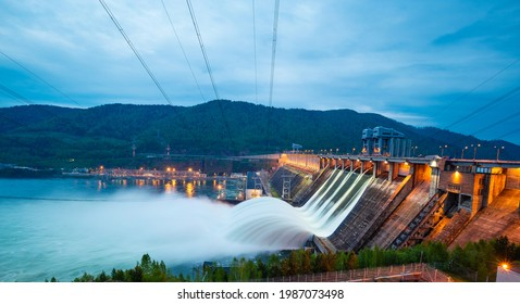 view of the hydroelectric dam, water discharge through locks, long exposure shooting