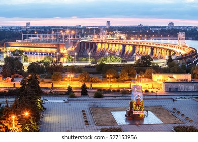 View of hydroelectric station, new Ukrainian monument without Lenin and river in evening, Zaporozhye, Dnieper, Ukraine