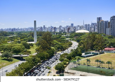 View of Ibirapuera Park, obelisk and building of the city of Sao Paulo in sunny afternoon. Brazil.