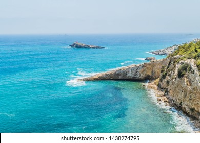 A view of the Ibiza coastline with the turquoise Mediterranean sea and pretty coves and headland, taken from near Dalt Villa in Ibiza Old Town, Ibiza, Balearic Islands
