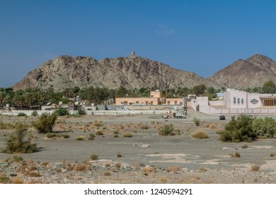 View of Ibra town with watchtowers on hills, Oman