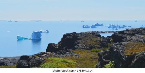 View of icebergs from Disko Island, Greenland