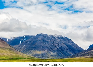 View of icelandic mountains under clouds
