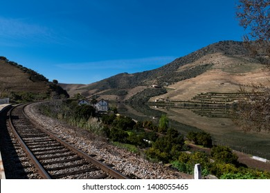 View of the iconic Quinta do Vesuvio with the Douro River and the train tracks in the Douro Valley; Concept for travel in Portugal