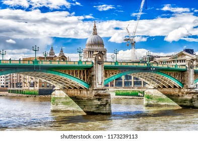 View of the iconic St. Paul Cathedral over Southwark Bridge, London, UK