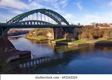 View of Sunderland's iconic structures: Wearmouth Bridge above the River Wear and Stadium of Light football stadium in the background