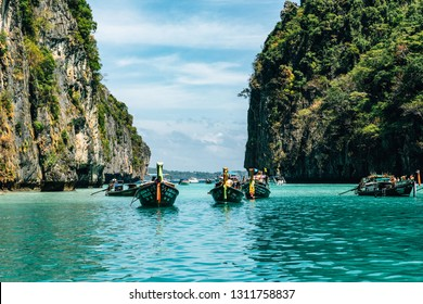 view of iconic tropical turquoise water Pileh Lagoon surrounded by limestone cliffs, Phi Phi islands, Thailand
