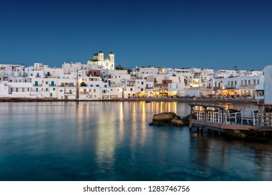 View to the idyllic fishing village Naousa on the island of Paros, Greece, during evening