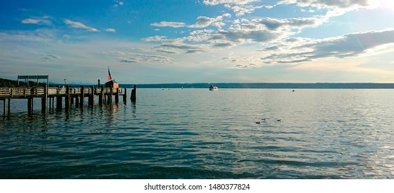 """View of the idyllic lake """"Ammersee"""" near Munich in Bavaria before sunset"""