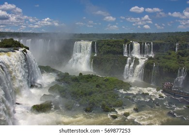 view of the Iguazu Falls and the observation deck with tourists from Brazil