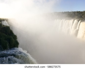View of the Iguazu (Iguacu) falls, the largest series of waterfalls on the planet, between Brazil, Argentina, and Paraguay with up to 275 waterfalls cascading along 2,700 meters (1.6 miles) cliffs.