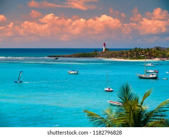 View of Ilet du Gosier in Guadeloupe, French West Indies, with boats anchoring in the bay