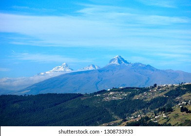 View of Illinizas and Corazon Mountains from south of Quito city.