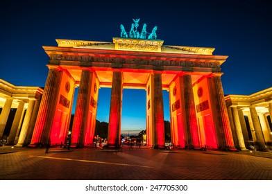 view of the illuminated Brandenburg Gate in Berlin