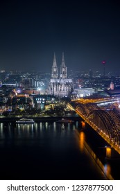 View of the illuminated City of Cologne, the Cologne Cathedral, the Hohenzollernbridge and the River Rhine in Germany Cologne 2018.