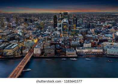 View to the illuminated City of London after sunset; the urban skyline of a modern metropolis, United Kingdom