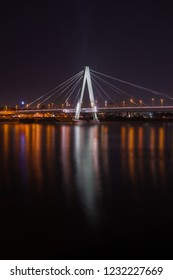 View of the illuminated Deutzer Bridge and the Long River Rhine at Night in Germany Cologne 2018.