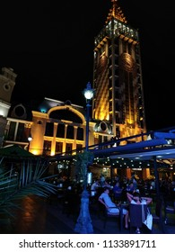 View of the illuminated evening city, cafes, restaurants and a tower, Piazza, Batumi, Georgia - 28 Jun 2018