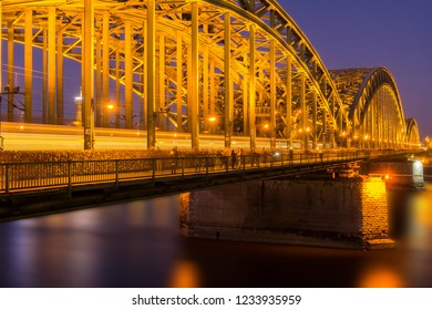 View of the illuminated Hohenzollernbridge and the River Rhine at Night in Germany Cologne 2018.