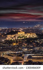 View to the illuminated Parthenon Temple at the Acropolis of Athens, Greece, after sunset time