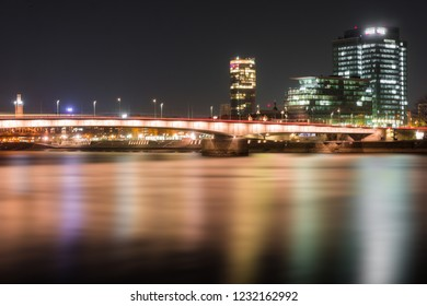 View of the illuminated Skyscraper Cologne Triangle, the Deutzer Bridge, the Lanxess Building and the Long River Rhine (one of the longest Rivers in Europe) at Night in Cologne in 2018.