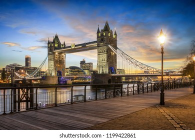 View to the illuminated Tower Bridge of London, a major sight for tourists, just after sunset, United Kingdom
