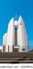 """View of Immaculate Heart of Mary Cathedral in Irkutsk. The building is made in the style of constructivism. The inscription on the church - Veni, Sancte Spiritus from the Latin """"Come, Holy Spirit""""."""