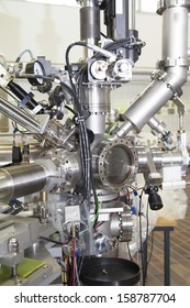 View of Important electronic and mechanical parts of Mass spectrometer in ION Accelerator command room, CNC machined parts, tilt shift lens, selective focus