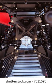 View of independent suspension underneath an all-terrain-vehicle