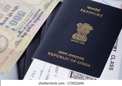 view of indian passport with airline boarding pass and some cash.