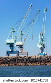 view of industrial cranes on a loading and unloading dock