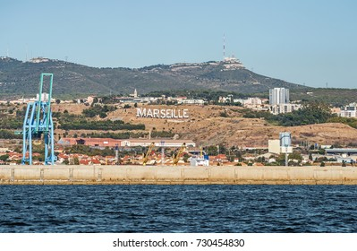 View of the industrial harbor of Marseille and its Hollywood-like lettering  in South France