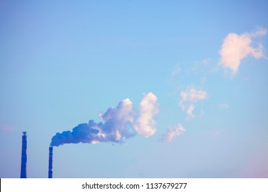view of industrial pipes with smoke