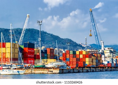 View of the industrial port in La Spezia town, Liguria, Italy. Many colorful cargo containers for transportation