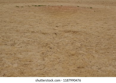 A view of the infield dirt texture surface on the baseball field and a closeup view.