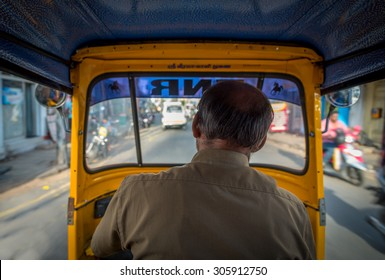 View from the inside of an auto-rickshaw in India,  the Hindu God's name 'Sri Veera Kaali' is written above the windshield.
