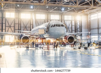 View inside the aviation hangar, the airplane mechanic working around the service