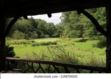 View from inside a gazebo in a beautiful park. Summer season.