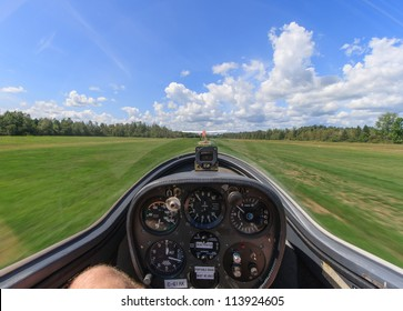 The view from inside a glider as it is being towed by another plane down a grass airfield in Manotick, Ontario, Canada.