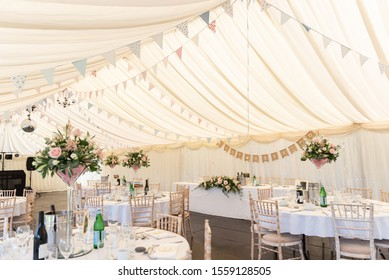 A view inside a marquee set up for a wedding reception