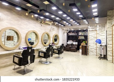 View inside of a modern salon showing mirrors and sitting arrangement. Beauty parlour interiors.